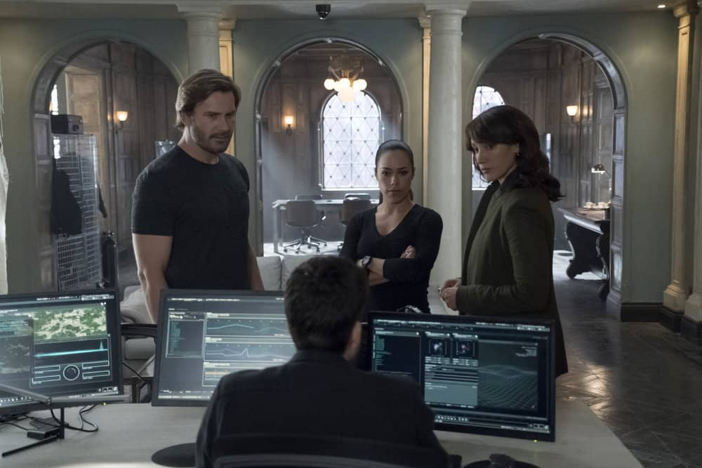 "TAKEN -- ""Hammurabi"" Episode 203 -- Pictured: (l-r) Clive Standen as Bryan Mills, Jessica Camacho as Santana, Jennifer Beals as Christina Hart -- (Photo by: Panagiotis Pantazidis/NBC)"