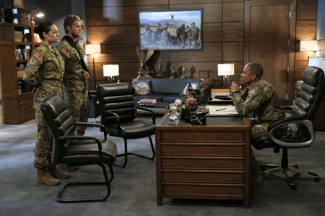 "Valor -- ""Costs of War"" -- Image Number: VAL113c_0108b.jpg -- Pictured (L-R): Christina Ochoa as Warrant Officer Nora Madani, Matt Barr as Captain Leland Gallo and Nigél Thatch as Colonel Robert Haskins -- Photo: Erika Doss -- © 2017 The CW Network, LLC All Rights Reserved."