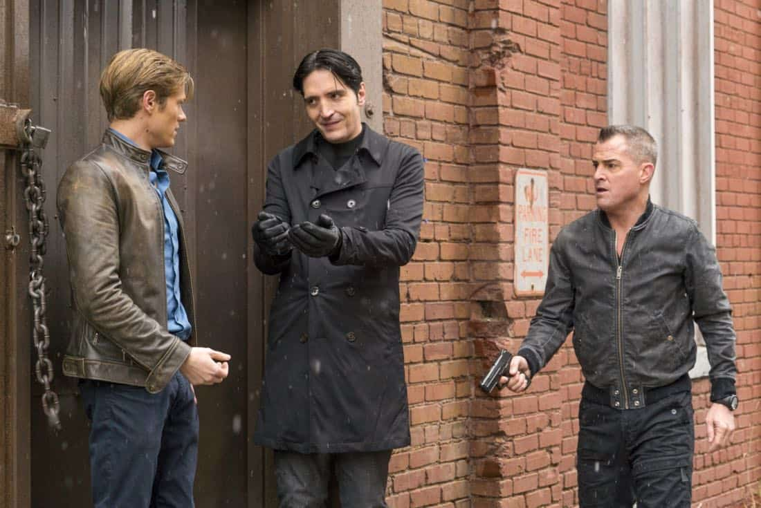 """Murdoc + Handcuffs"" -- After one of Murdoc's go-to assassins agrees to hand over Murdoc to MacGyver in exchange for $10 million, the team finds itself protecting Murdoc from his former mentor, Nicholas Helman, who wants him dead. Also, Jack realizes he may still have feelings for Riley's mother, Diane (Michael Michele), on MACGYVER, Friday, Feb. 2 (8:00-9:00 PM ET/PT) on the CBS Television Network. Michael Des Barres, who played Murdoc in the original ""MacGyver"" series, guest stars as Murdoc's mentor, Nicholas Helman. Pictured: Lucas Till, David Dastmalchian, George Eads.   Photo: Annette Brown/CBS ©2017 CBS Broadcasting, Inc. All Rights Reserved"