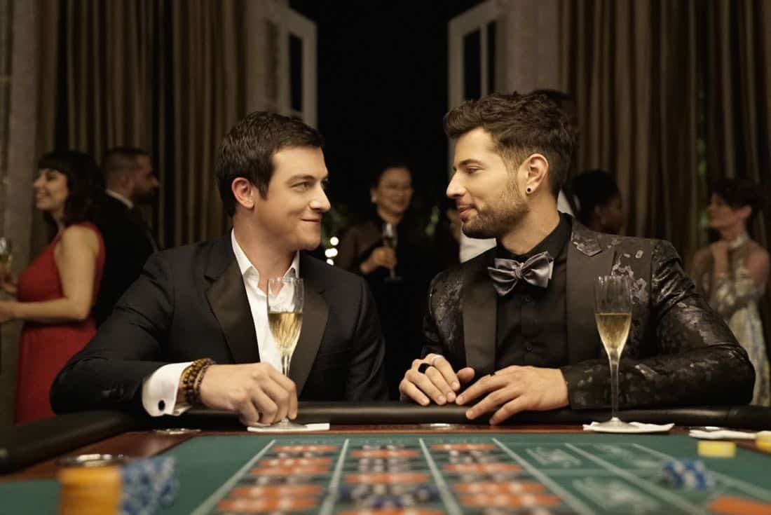 "Dynasty -- ""Promises You Can't Keep"" -- Image Number: DYN112b_0351b.jpg -- Pictured (L-R): James Mackay as Steven and Rafael De La Fuente as Sammy Jo -- Photo: Jace Downs/The CW -- © 2018 The CW Network, LLC. All Rights Reserved."