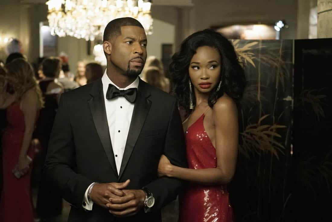 "Dynasty -- ""Promises You Can't Keep"" -- Image Number: DYN112b_0540b.jpg -- Pictured (L-R): Robert Christopher Riley as Culhane and Wakeema Hollis as Monica -- Photo: Jace Downs/The CW -- © 2018 The CW Network, LLC. All Rights Reserved."