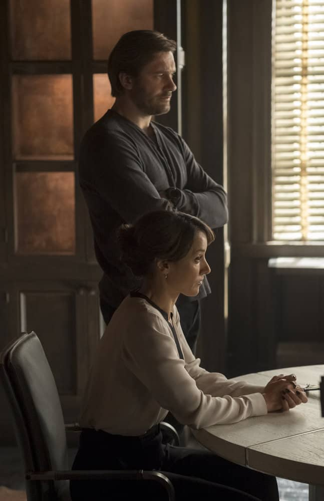 "TAKEN -- ""OPSEC"" Episode 204 -- Pictured: (l-r) Clive Standen as Bryan Mills, Jennifer Beals as Christina Hart -- (Photo by Panagiotis Pantazidis/NBC)"