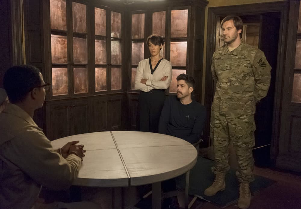 "TAKEN -- ""OPSEC"" Episode 204 -- Pictured: (l-r) Jennifer Beals as Christina Hart, Adam Goldberg as Kilroy, Clive Standen as Bryan Mills -- (Photo by Panagiotis Pantazidis/NBC)"