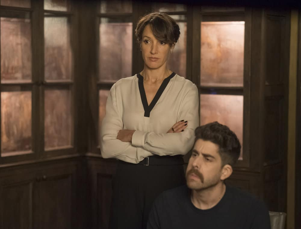 "TAKEN -- ""OPSEC"" Episode 204 -- Pictured: (l-r) Jennifer Beals as Christina Hart, Adam Goldberg as Kilroy -- (Photo by Panagiotis Pantazidis/NBC)"