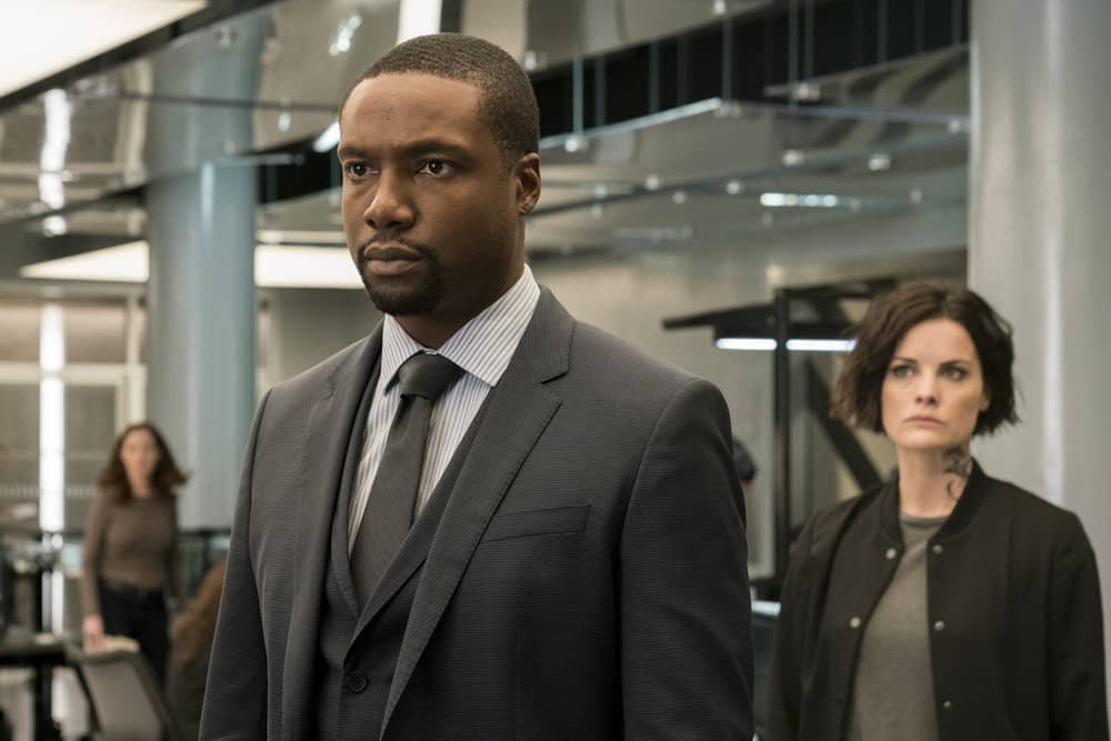 "BLINDSPOT -- ""Two Legendary Chums"" Episode 312 --  Pictured: (l-r) Rob Brown as Edgar Reade, Jaimie Alexander as Jane Doe -- (Photo by: David Giesbrecht/NBC/Warner Bros.)"
