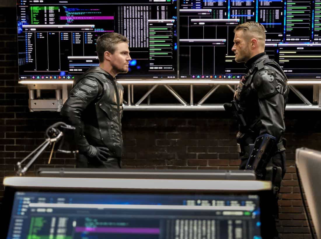 "Arrow -- ""All for Nothing"" -- Image Number: AR612a_.jpg -- Pictured (L-R): Stephen Amell as Oliver Queen/Green Arrow and Johann Urb as Sonny Pederson -- Photo: Bettina Strauss/The CW -- © 2018 The CW Network, LLC. All rights Reserved."