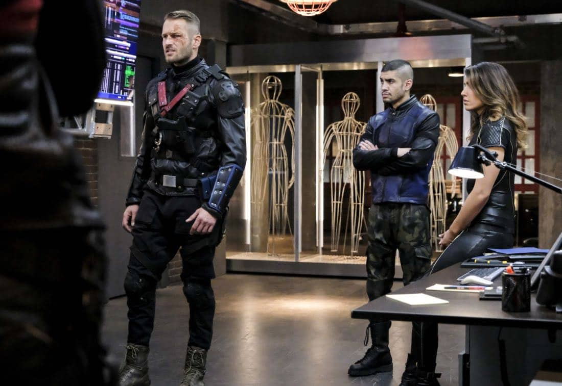 "Arrow -- ""All for Nothing"" -- Image Number: AR612a_.jpg -- Pictured (L-R): Johann Urb as Sonny Pederson, Rick Gonzalez as Rene Ramirez/Wild Dog and Juliana Harkavy as Dinah Drake/Black Canary -- Photo: Bettina Strauss/The CW -- © 2018 The CW Network, LLC. All rights Reserved."