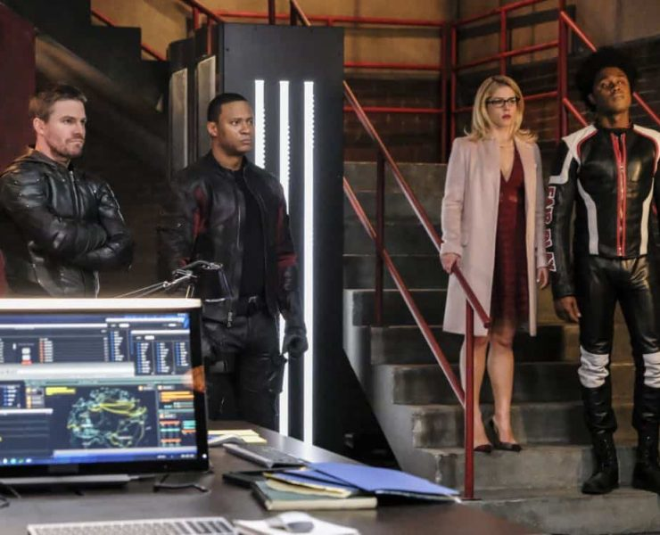 "Arrow -- ""All for Nothing"" -- Image Number: AR612a_0035.jpg -- Pictured (L-R): Stephen Amell as Oliver Queen/Green Arrow, David Ramsey as John Diggle/Spartan, Emily Bett Rickards as Felicity and Echo Kellum as Curtis Holt/Mr. Terrific -- Photo: Bettina Strauss/The CW -- © 2018 The CW Network, LLC. All rights Reserved."
