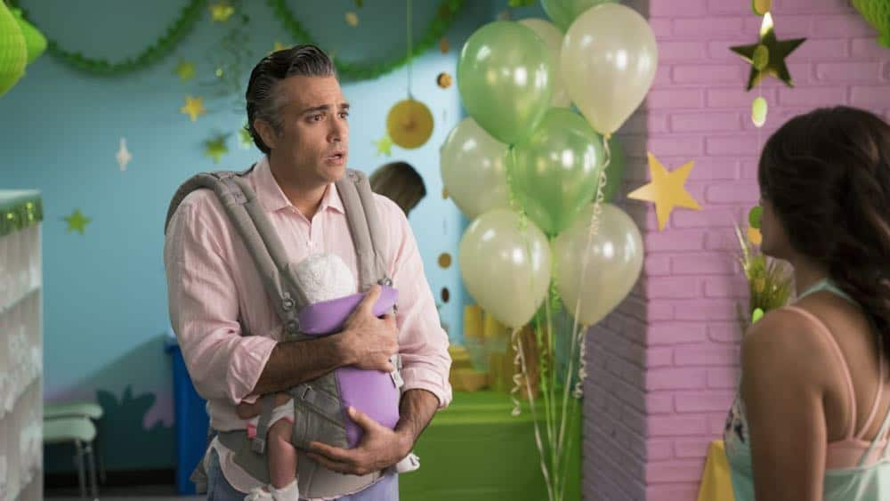 """Jane The Virgin -- """"Chapter Seventy-Three"""" -- Image Number: JAV409b_0013.jpg -- Pictured (L-R): Jaime Camil as Rogelio and Andrea Navedo as Xo -- Photo: Michael Desmond/The CW -- © 2018 The CW Network, LLC. All Rights Reserved."""