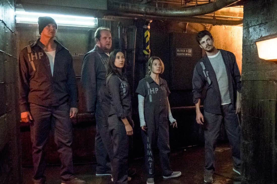 """The Flash -- """"True Colors"""" -- Image Number: FLA413a_0062b.jpg -- Pictured (L-R): Derek Mears as Slybert Rundine, Dominic Burgess as Ramsey Deacon, Chelsea Kurtz as Mina Chaytan, Sugar-Lyn Beard as Becky/Hazard and Grant Gustin as Barry Allen -- Photo: Katie Yu/The CW -- © 2018 The CW Network, LLC. All rights reserved"""