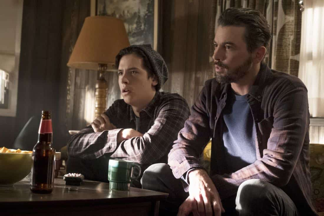 """Riverdale -- """"Chapter Twenty-Six: The Tell-Tale Heart"""" -- Image Number: RVD213b_0114.jpg -- Pictured (L-R): Cole Spouse as Jughead and Skeet Ulrich as FP Jones -- Photo: Katie Yu/The CW -- © 2018 The CW Network, LLC. All Rights Reserved."""