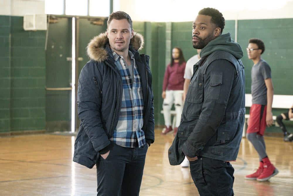 "CHICAGO P.D. -- ""Anthem"" Episode 514 -- Pictured: (l-r) Patrick John Flueger as Adam Ruzek, LaRoyce Hawkins as Kevin Atwater -- (Photo by: Matt Dinerstein/NBC)"