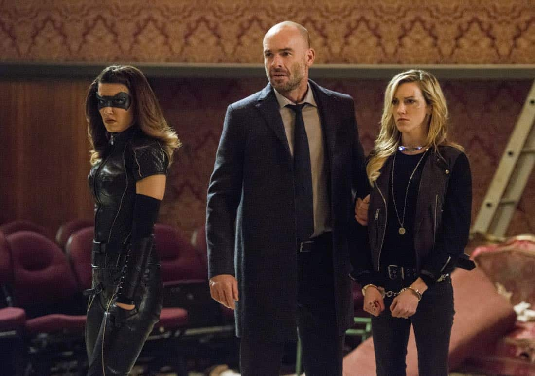 """Arrow -- """"The Devil's Greatest Trick"""" -- Image Number: AR613a_0320.jpg -- Pictured (L-R): Juliana Harkavy as Dinah Drake/Black Canary, Paul Blackthorne as Quentin Lance and Katie Cassidy as Laurel/Black Siren -- Photo: Diyah Pera/The CW -- © 2018 The CW Network, LLC. All Rights reserved."""