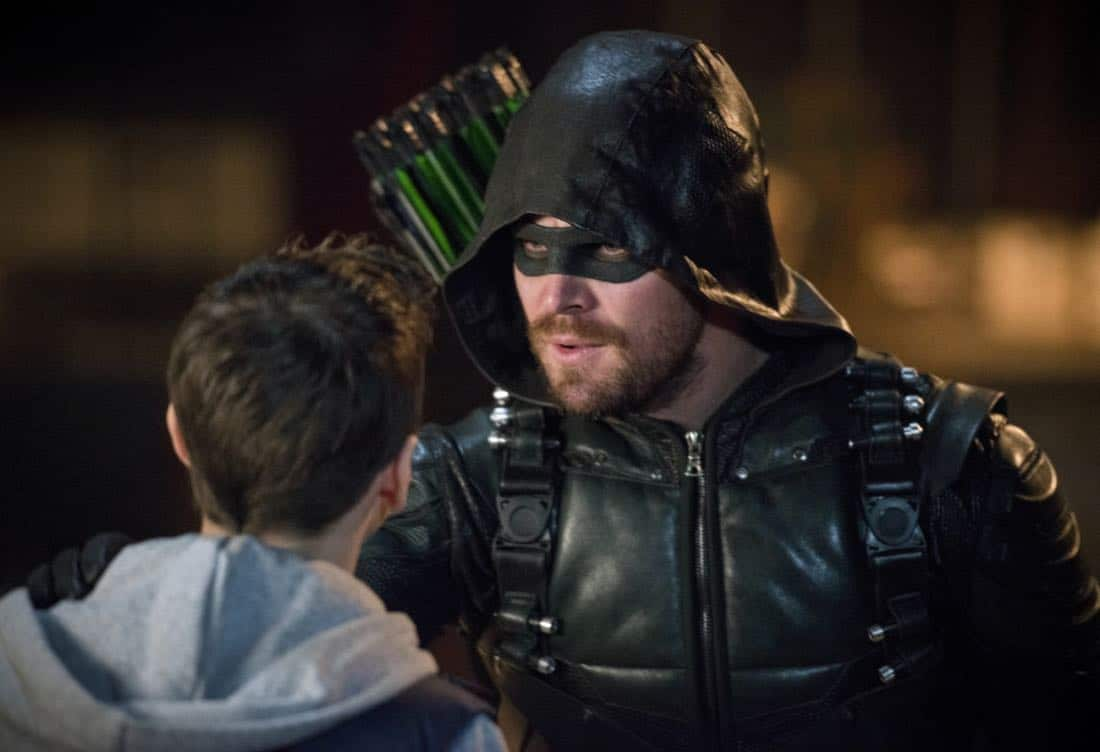 "Arrow -- ""The Devil's Greatest Trick"" -- Image Number: AR613a_0068.jpg -- Pictured (L-R): Jack Moore as William Clayton and Stephen Amell as Oliver Queen/Green Arrow -- Photo: Diyah Pera/The CW -- © 2018 The CW Network, LLC. All Rights reserved."