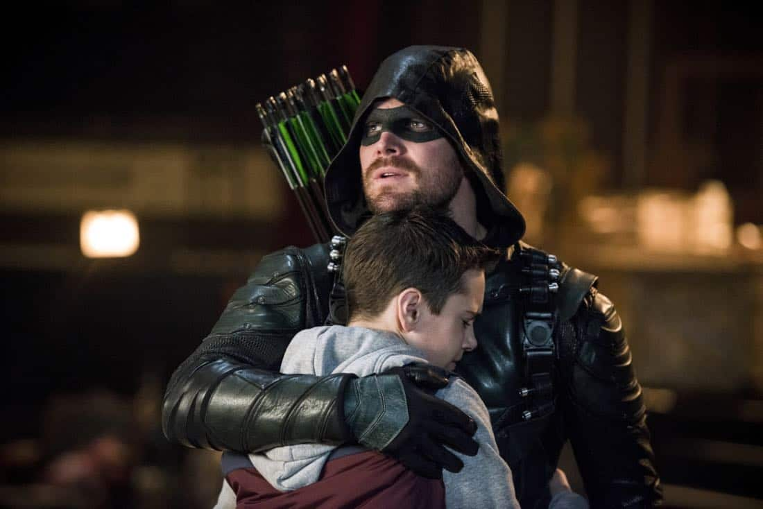 "Arrow -- ""The Devil's Greatest Trick"" -- Image Number: AR613a_0072.jpg -- Pictured (L-R): Jack Moore as William Clayton and Stephen Amell as Oliver Queen/Green Arrow -- Photo: Diyah Pera/The CW -- © 2018 The CW Network, LLC. All Rights reserved."
