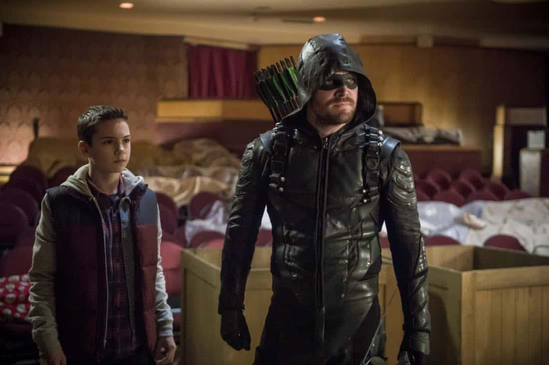 "Arrow -- ""The Devil's Greatest Trick"" -- Image Number: AR613a_0124.jpg -- Pictured (L-R): Jack Moore as William Clayton and Stephen Amell as Oliver Queen/Green Arrow -- Photo: Diyah Pera/The CW -- © 2018 The CW Network, LLC. All Rights reserved."