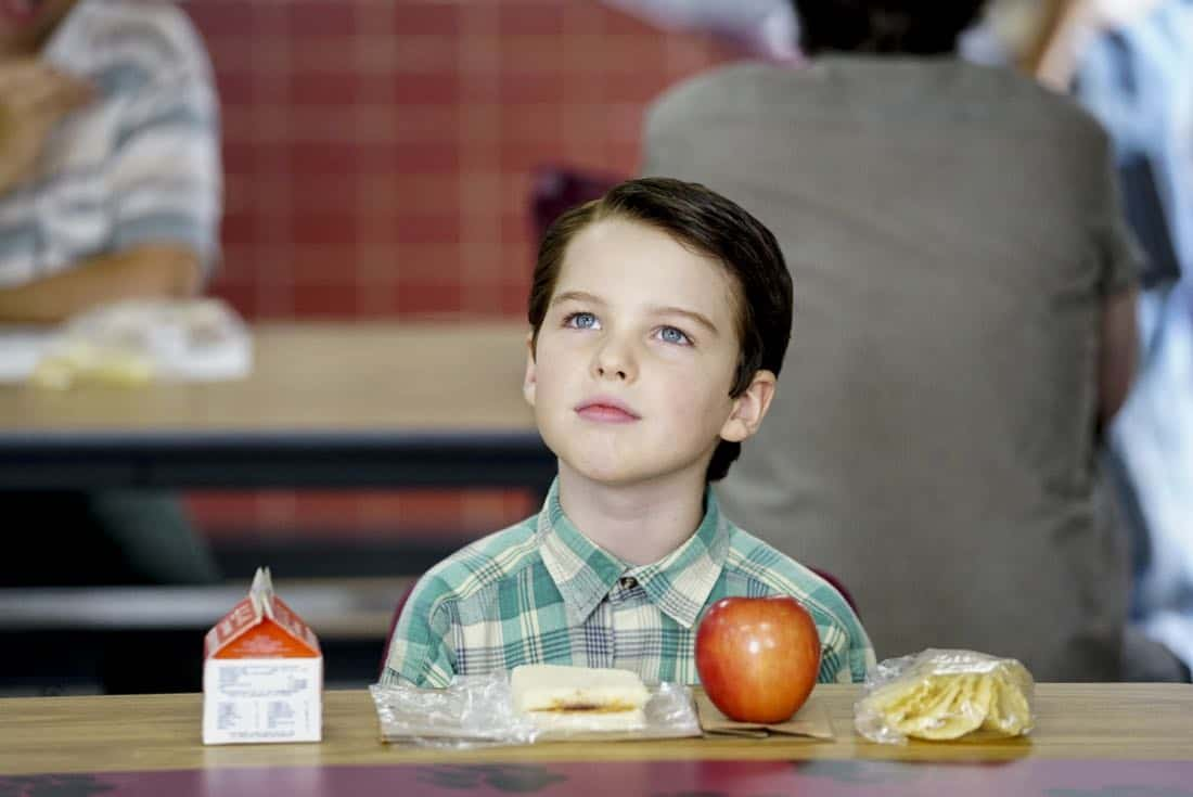"""Rockets, Communists, and the Dewey Decimal System""-- Pictured: Sheldon (Iain Armitage). To appease his worried mother, Sheldon employs the techniques of a self-help book to try and make a friend, when YOUNG SHELDON returns in its new time period, Thursday, Nov. 2 (8:31-9:01 PM, ET/PT) on the CBS Television Network. Photo: Sonja Flemming/CBS ©2017 CBS Broadcasting, Inc. All Rights Reserved."