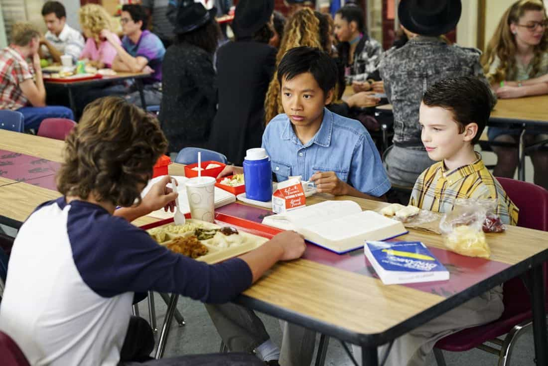 """""""Rockets, Communists, and the Dewey Decimal System""""-- Pictured: Tam (Ryan Phuong) and Sheldon (Iain Armitage). To appease his worried mother, Sheldon employs the techniques of a self-help book to try and make a friend, when YOUNG SHELDON returns in its new time period, Thursday, Nov. 2 (8:31-9:01 PM, ET/PT) on the CBS Television Network.  Photo: Sonja Flemming/CBS ©2017 CBS Broadcasting, Inc. All Rights Reserved."""
