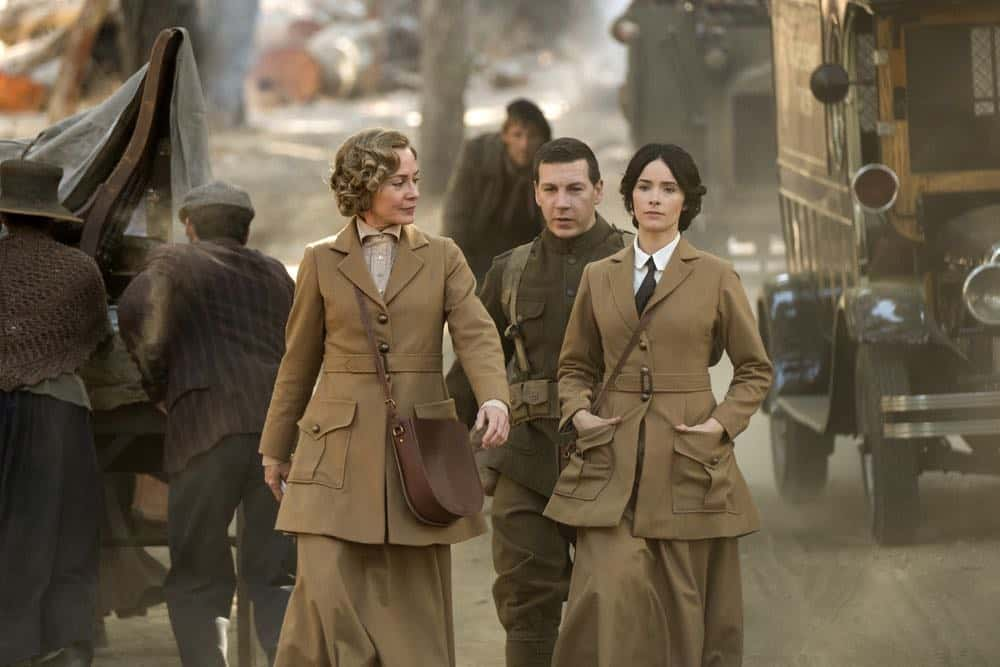 "TIMELESS -- ""The War to End All Wars"" Episode 201 -- Pictured: (l-r) Susanna Thompson as Carol, Johnathan Stanley as Mac, Abigail Spencer as Lucy Preston -- (Photo by: Justin Lubin/NBC)"