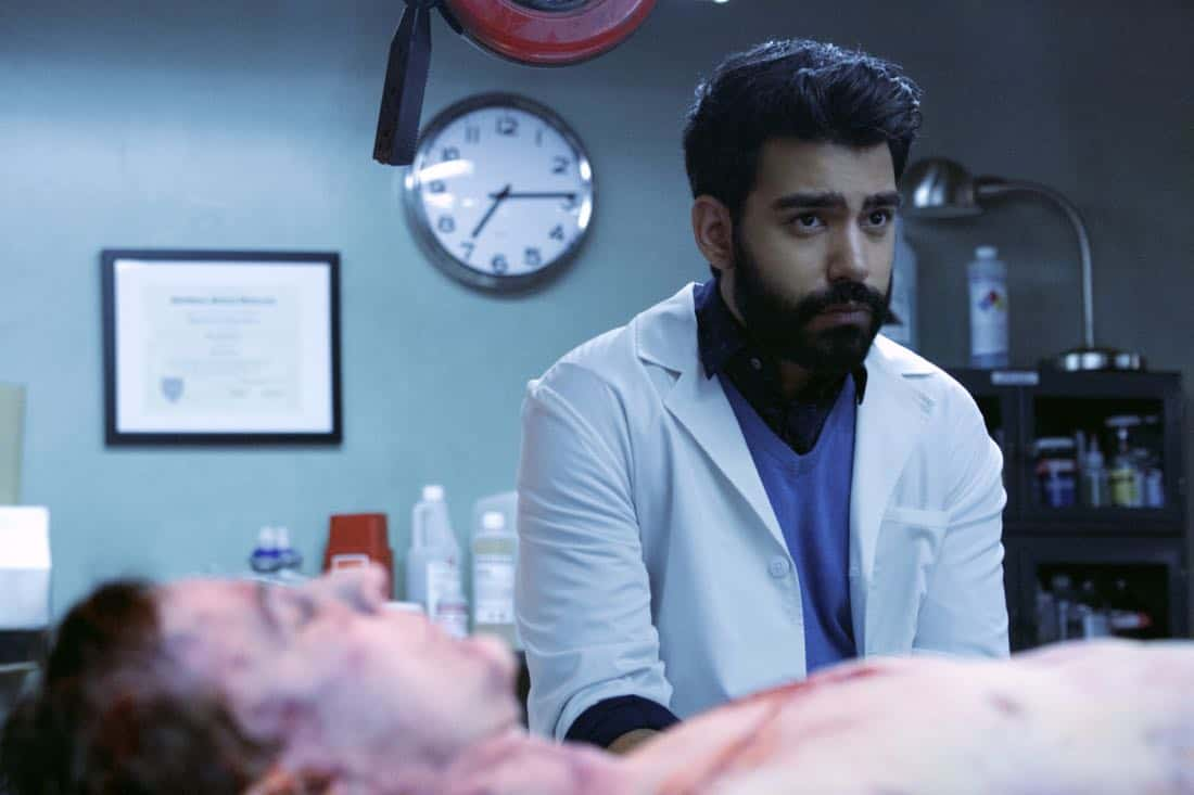 """iZombie -- """"Blue Bloody"""" -- Image Number: ZMB402a_0437.jpg -- Pictured: Rahul Kohli as Ravi -- Photo: Shane Harvey/The CW -- © 2018 The CW Network, LLC. All rights reserved."""