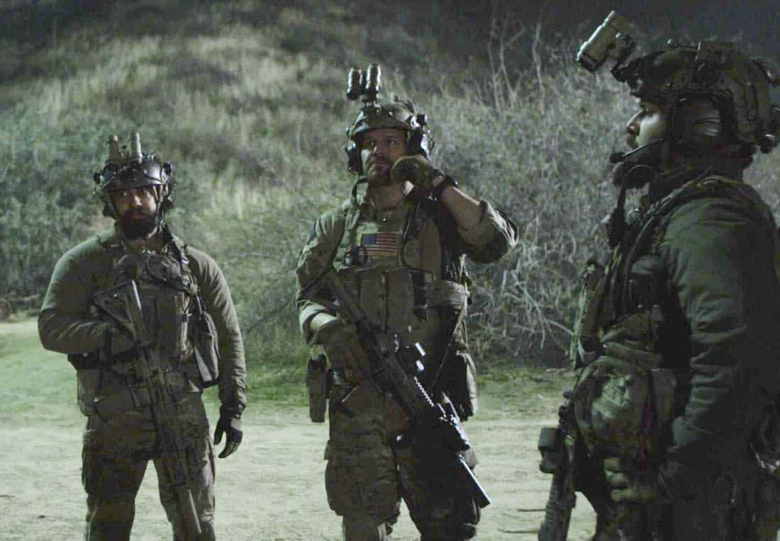 """""""No Man's Land"""" -  Jason and the SEAL Team close in on avenging the deaths of Echo Team when they find the money that funded their murder on a nearby poppy farm that was previously used to make heroin. Also, Jason meets an intriguing woman on the base, on SEAL TEAM, Wednesday, March 7 (9:01-10:00 PM, ET/PT) on the CBS Television Network. Pictured left to right: Neil Brown Jr as Ray Perry, and David Boreanaz as Jason Hayes and AJ Buckley as Sonny Quinn. Photo: Screengrab/CBS ©2018 CBS Broadcasting, Inc. All Rights Reserved"""