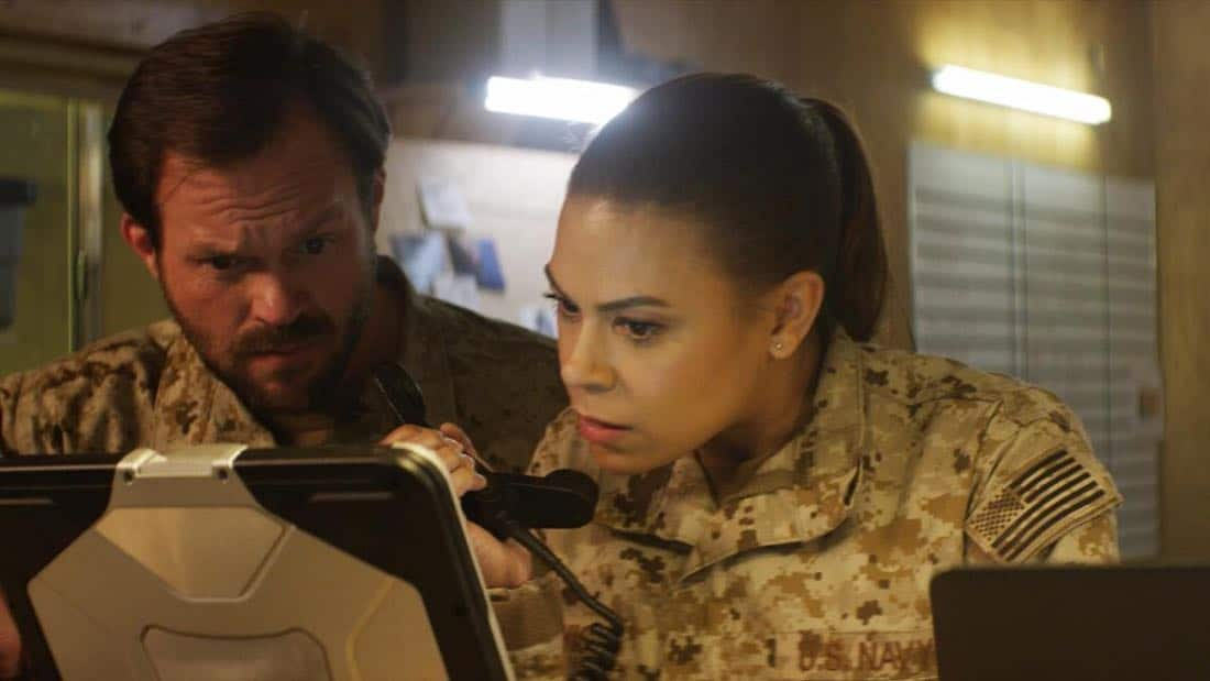 """""""No Man's Land""""  - Jason and the SEAL Team close in on avenging the deaths of Echo Team when they find the money that funded their murder on a nearby poppy farm that was previously used to make heroin. Also, Jason meets an intriguing woman on the base, on SEAL TEAM, Wednesday, March 7 (9:01-10:00 PM, ET/PT) on the CBS Television Network. Pictured left to right: Judd Lormand as Blackburn and Toni Trucks as Lisa Davis. Photo: Screengrab/CBS ©2018 CBS Broadcasting, Inc. All Rights Reserved"""
