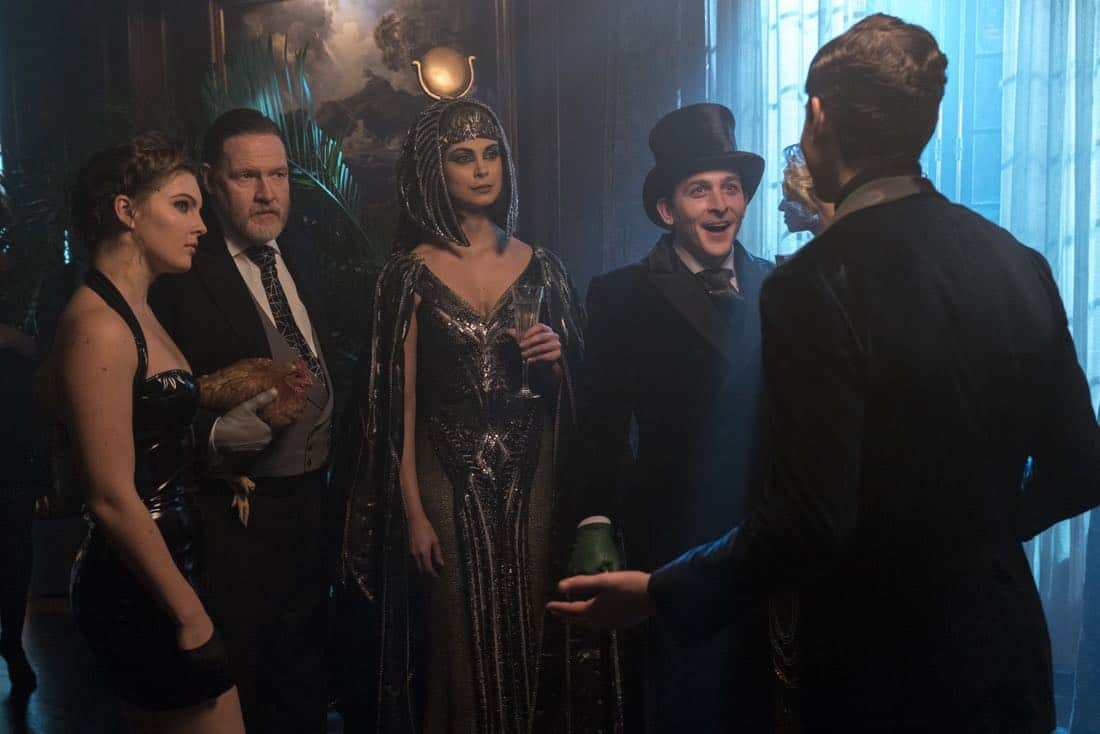 "GOTHAM: L-R: Camren Bicondova, Donal Logue, Morena Baccarin and Robin Lord Taylor in the ""A Dark Knight: A Beautiful Darkness"" episode of GOTHAM airing Thursday, March 8 (8:00-9:00 PM ET/PT) on FOX.  ©2018 Fox Broadcasting Co. Cr: David Giesbrecht/FOX"