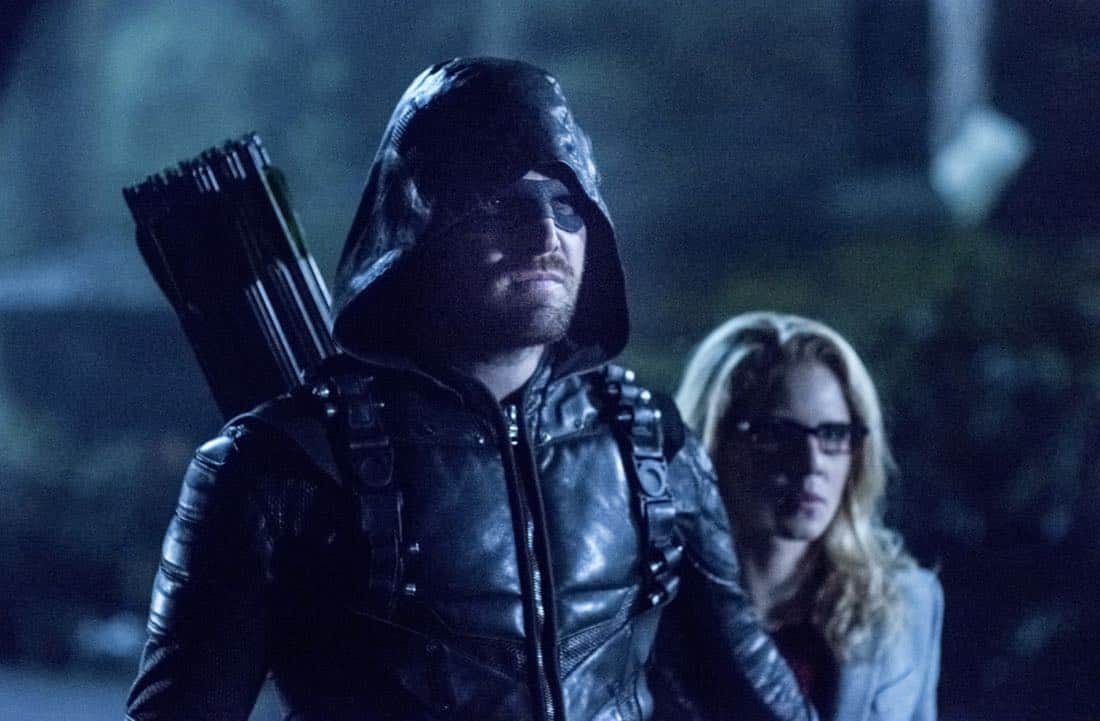 "Arrow -- ""Collision Course"" -- Image Number: ARR614a_0226.jpg -- Pictured (L-R): Stephen Amell as Oliver Queen/Green Arrow and Emily Bett Rickards as Felicity Smoak -- Photo: Dean Buscher/The CW -- © 2018 The CW Network, LLC. All rights reserved."