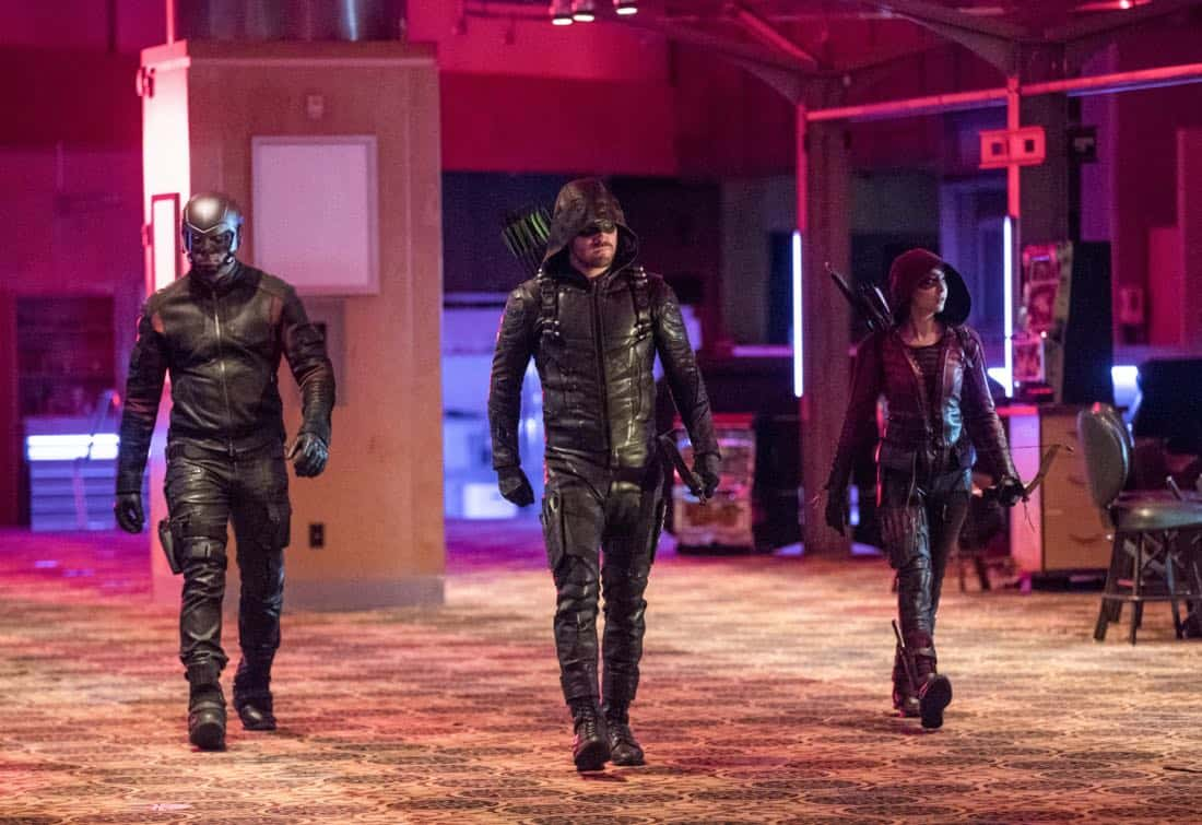 "Arrow -- ""Doppelganger"" -- Image Number: ARR615a_0064.jpg -- Pictured (L-R): David Ramsey as John Diggle/Spartan, Stephen Amell as Oliver Queen/Green Arrow and Willa Holland as Thea Queen/Speedy -- Photo: Jack Rowand/The CW -- © 2018 The CW Network, LLC. All rights reserved."