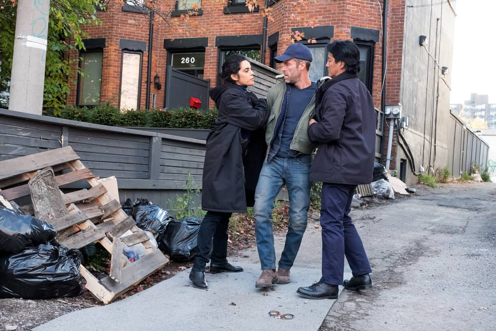 "FALLING WATER -- ""Risk Assessment"" Episode 209 -- Pictured: (l-r) Sepideh Moafi as Alexis Simms, JR Bourne as Tom Dolan, Will Yun Lee as Taka -- (Photo by: Iden Ford/USA Network)"