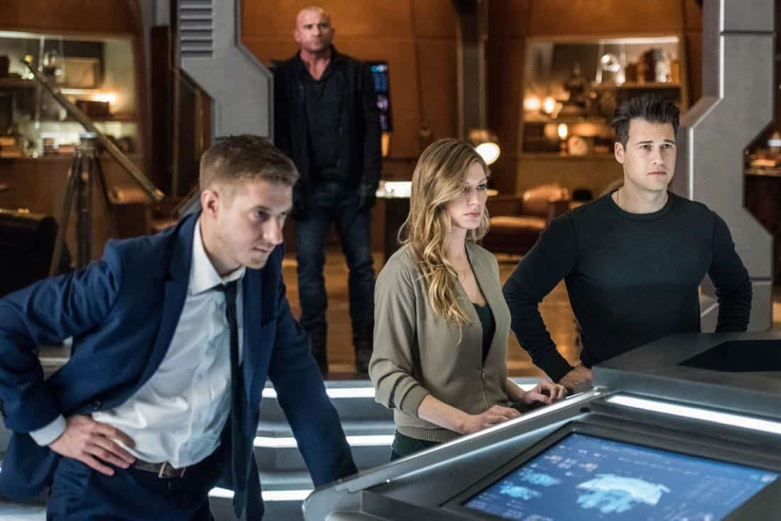 "DC's Legends of Tomorrow -- ""No Country for Old Dads"" -- Image Number: LGN313b_0113b.jpg -- Pictured (L-R): Arthur Darvill as Rip Hunter, Dominic Purcell as Mick Rory/Heat Wave, Jes Macallan as Ava Sharpe and Nick Zano as Nate Heywood/Steel -- Photo: Dean Buscher/The CW -- © 2018 The CW Network, LLC. All Rights Reserved."