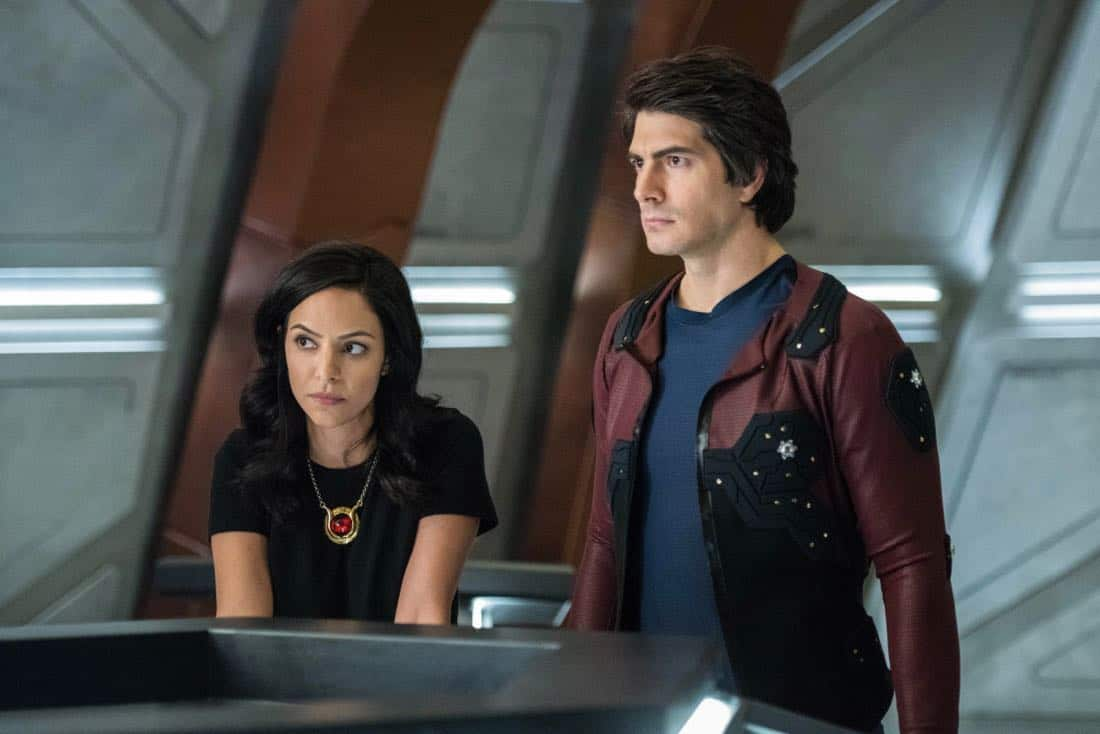 "DC's Legends of Tomorrow -- ""No Country for Old Dads"" -- Image Number: LGN313b_0198b.jpg -- Pictured (L-R): Tala Ashe as Zari and Brandon Routh as Ray Palmer/Atom -- Photo: Dean Buscher/The CW -- © 2018 The CW Network, LLC. All Rights Reserved."