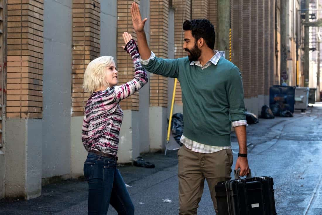 "iZombie -- ""Brainless in Seattle, Part 1"" -- Image Number: ZMB403a_0022.jpg -- Pictured (L-R): Rose McIver as Liv and Rahul Kohli as Ravi -- Photo: Katie Yu/The CW -- © 2018 The CW Network, LLC. All Rights Reserved."