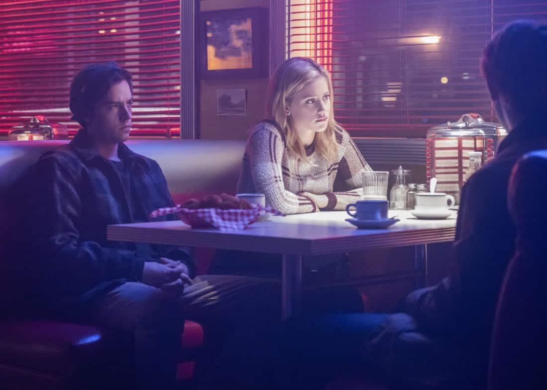 """Riverdale -- """"Chapter Twenty-Seven: The Hills Have Eyes"""" -- Image Number: RVD214a_0316.jpg -- Pictured (L-R): Cole Spouse as Jughead and Lili Reinhart as Betty -- Photo: Dean Buscher/The CW -- © 2018 The CW Network, LLC. All rights reserved."""