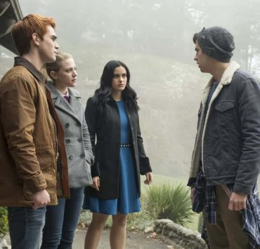 """Riverdale -- """"Chapter Twenty-Seven: The Hills Have Eyes"""" -- Image Number: RVD214b_0136.jpg -- Pictured (L-R): KJ Apa as Archie, Lili Reinhart as Betty, Camila Mendes as Veronica and Cole Spouse as Jughead -- Photo: Katie Yu/The CW -- © 2018 The CW Network, LLC. All rights reserved."""