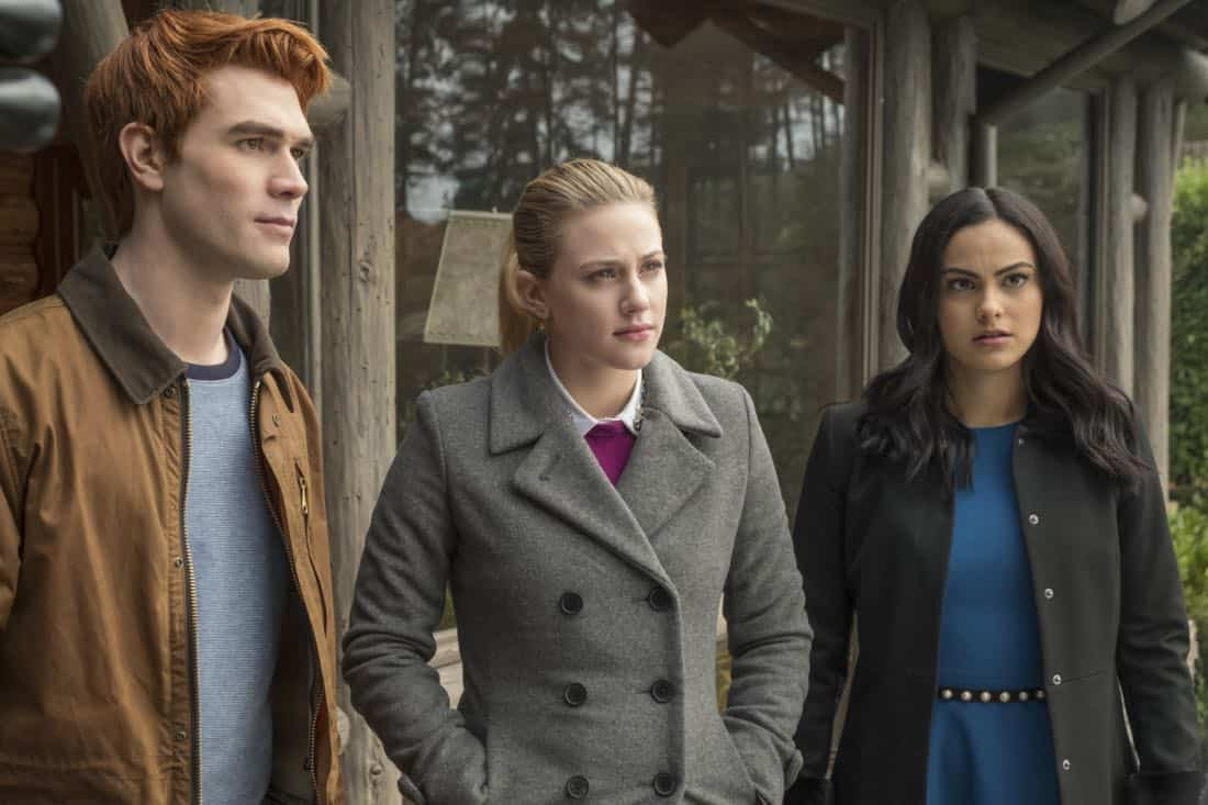 """Riverdale -- """"Chapter Twenty-Seven: The Hills Have Eyes"""" -- Image Number: RVD214B_0157.jpg -- Pictured (L-R): KJ Apa as Archie, Lili Reinhart as Betty and Camila Mendes as Veronica -- Photo: Katie Yu/The CW -- © 2018 The CW Network, LLC. All rights reserved."""