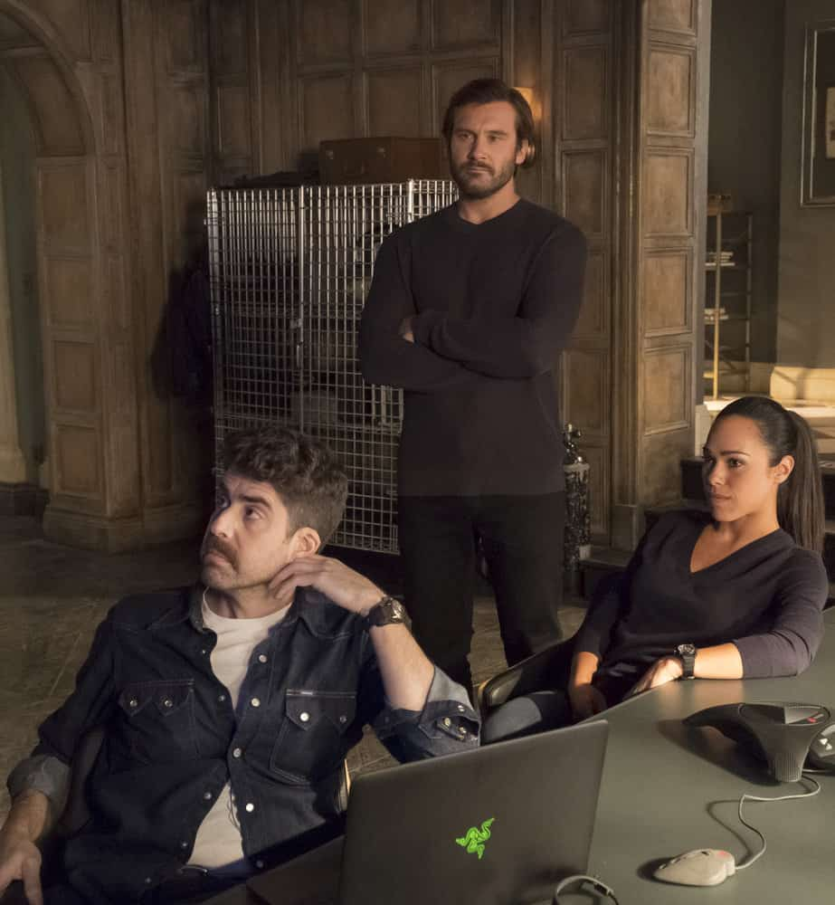 "TAKEN -- ""Invitation Only"" Episode 207 -- Pictured: (l-r) Adam Goldberg as Kilroy, Clive Standen as Bryan Mills, Jessica Camacho as Santana -- (Photo by: Panagiotis Pantazidis/NBC)"