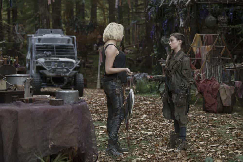"The 100 -- ""Eden"" -- Image Number: HUN501a_0411.jpg -- Pictured (L-R): Eliza Taylor as Clarke and Lola Flanery as Madi -- Photo: Jack Rowand/The CW -- © 2018 The CW Network, LLC. All rights reserved."