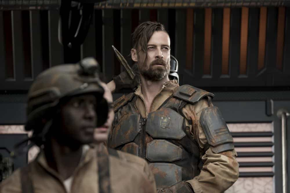 "The 100 -- ""Eden"" -- Image Number: HUN501b_0246.jpg -- Pictured: William Miller as McCreary -- Photo: Katie Yu/The CW -- © 2018 The CW Network, LLC. All rights reserved."