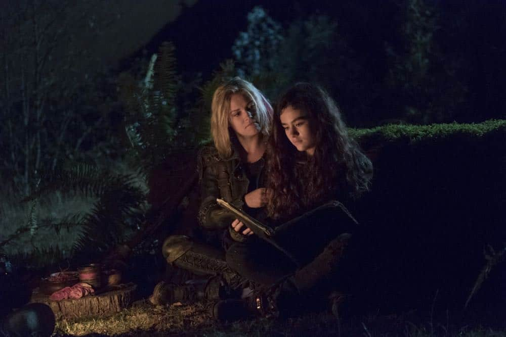 "The 100 -- ""Eden"" -- Image Number: HUN501b_0293.jpg -- Pictured: Eliza Taylor as Clarke and Lola Flanery as Madi -- Photo: Katie Yu/The CW -- © 2018 The CW Network, LLC. All rights reserved."