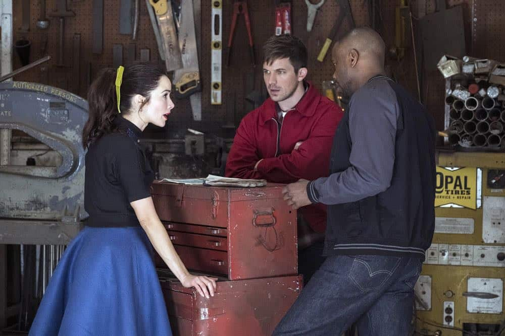 "TIMELESS -- ""The Darlington 500"" Episode 202 -- Pictured: (l-r) Abigail Spencer as Lucy Preston, Matt Lanter as Wyatt Logan, Malcolm Barrett as Rufus Carlin -- (Photo by: Justin Lubin/NBC)"