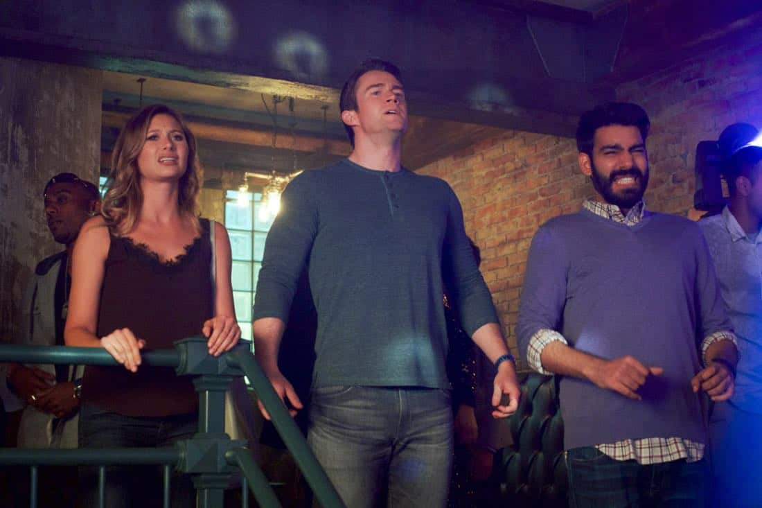 """iZombie -- """"Brainless in Seattle, Part 2"""" -- Image Number: ZMB404b_0084.jpg -- Pictured (L-R): Aly Michalka as Peyton, Robert Buckley as Major and Rahul Kohli as Ravi -- Photo: Shane Harvey/ The CW -- © 2018 The CW Network, LLC. All rights reserved."""