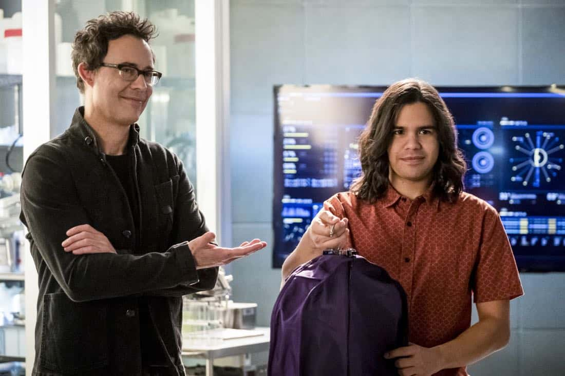 "The Flash -- ""Run, Iris, Run"" -- Image Number: FLA416b_0206bjpg -- Pictured (L-R): Tom Cavanagh as Harrison Wells and Carlos Valdes as Cisco Ramon -- Photo: Katie Yu/The CW -- © 2018 The CW Network, LLC. All rights reserved"