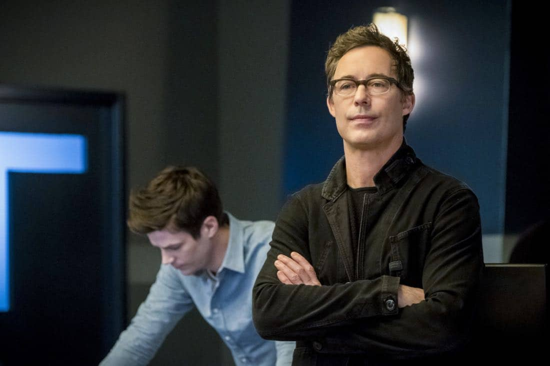 "The Flash -- ""Run, Iris, Run"" -- Image Number: FLA416b_0032b.jpg -- Pictured (L-R): Grant Gustin as Barry Allen and Tom Cavanagh as Harrison Wells -- Photo: Katie Yu/The CW -- © 2018 The CW Network, LLC. All rights reserved"