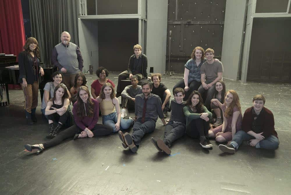 RISE -- Pilot -- Pictured: (l-r) Back row: Rosie Perez as Tracey Wolfe, Tom Riis Farrell as Mr. Baer, Rarmian Newton as Maashous Evers, Shannon Purser as Anabelle, Sean Grandillo as Jeremy Middle row: Joshua Grosso as Singer, Rachel Hilson as Harmony Curtis, Cheryl Bell as Singer, Brett Gray as Singer, Damon J. Gillespie as Robbie Thorne, Alexis Molnar as Singer Front row: Erin Kommor as Sasha, Amy Forsyth as Gwen Strickland, Katherine Reis as Jolene, Josh Radnor as Lou Mazzuchelli, Ted Sutherland as Simon Saunders, Auli'i Cravalho as Lilette Suarez, Caroline Pluta as Singer, Ellie Desautels as Michael Hallowell-- (Photo by: Peter Kramer/NBC)