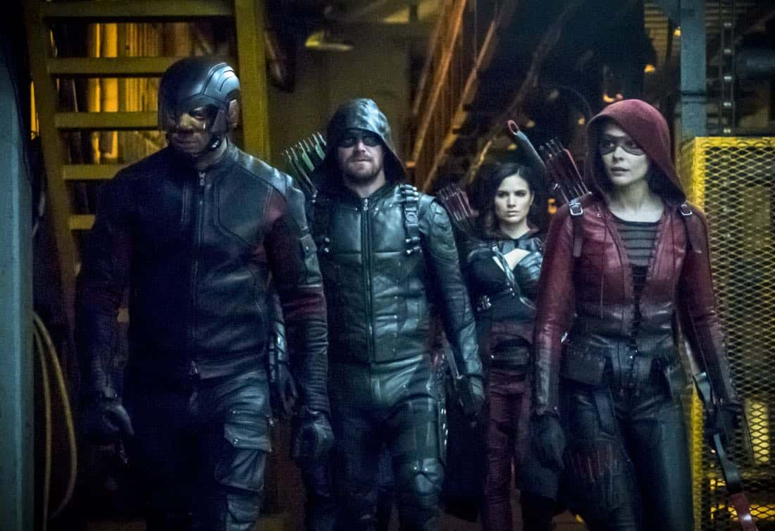 "Arrow -- ""The Thanatos Guild"" -- Image Number: AR616b_0150.jpg -- Pictured (L-R): David Ramsey as John Diggle/Spartan, Stephen Amell as Oliver Queen/Green Arrow, Katrina Law as Nyssa Al-Ghul and Willa Holland as Thea Queen/Speedy -- Photo: Katie Yu/The CW -- © 2018 The CW Network, LLC. All rights reserved."