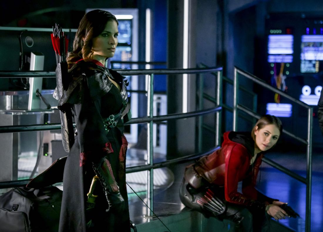 "Arrow -- ""The Thanatos Guild"" -- Image Number: AR616a_0183.jpg -- Pictured (L-R): Katrina Law as Nyssa Al-Ghul and Willa Holland as Thea Queen/Speedy -- Photo: Shane Harvey/The CW -- © 2018 The CW Network, LLC. All rights reserved."