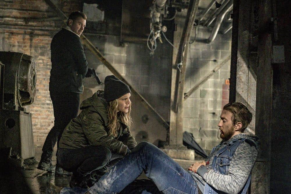 "CHICAGO P.D. -- ""Ghosts"" Episode 518 -- Pictured: (l-r) Patrick John Flueger as Adam Ruzek, Tracy Spiridakos as Hailey Upton, Christian Forrest as Jansen -- (Photo by: Matt Dinerstein/NBC)"