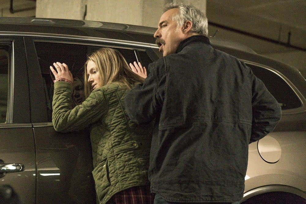 "CHICAGO P.D. -- ""Ghosts"" Episode 518 -- Pictured: (l-r) Tracy Spiridakos as Hailey Upton, Titus Welliver as Ronald Booth -- (Photo by: Matt Dinerstein/NBC)"