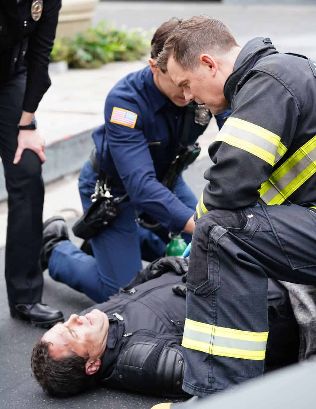 9-1-1: Guest star Andy Buckley (on ground) and Peter Krause (kneeling) in the season finale episode of 9-1-1 airs Wednesday, March 21 (9:00-10:00 PM ET/PT) on FOX. CR: Michael Becker / FOX, © 2018 FOX Broadcasting.